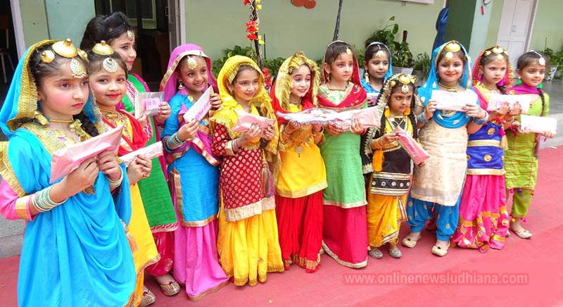 Students in traditional Punjabi outfits during Teej celebrations at Guru Nanak lnternational Public School