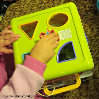 Putting shapes in shape sorter