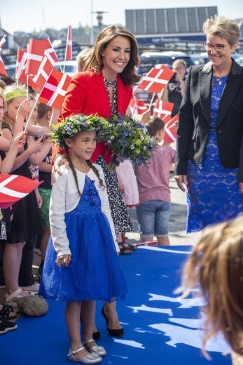 Princess Marie wore Alexander McQueen crepe jacket, and Tara Jarmon clover-print dress, Jimmy Choo pumps, carried Carlend Copenhagen clutch