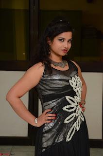 Shrisha Dasari in Sleeveless Short Black Dress At Follow Follow U Audio Launch 010.JPG