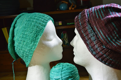 Mr. & Mrs. Creepy Head modeling hand knit hats and beanies for https://www.etsy.com/shop/JeannieGrayKnits