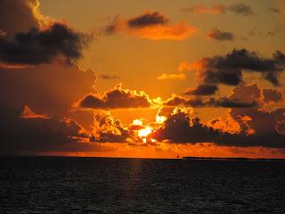 fiery orange sunset off the Sunset Cruise in Key West Florida
