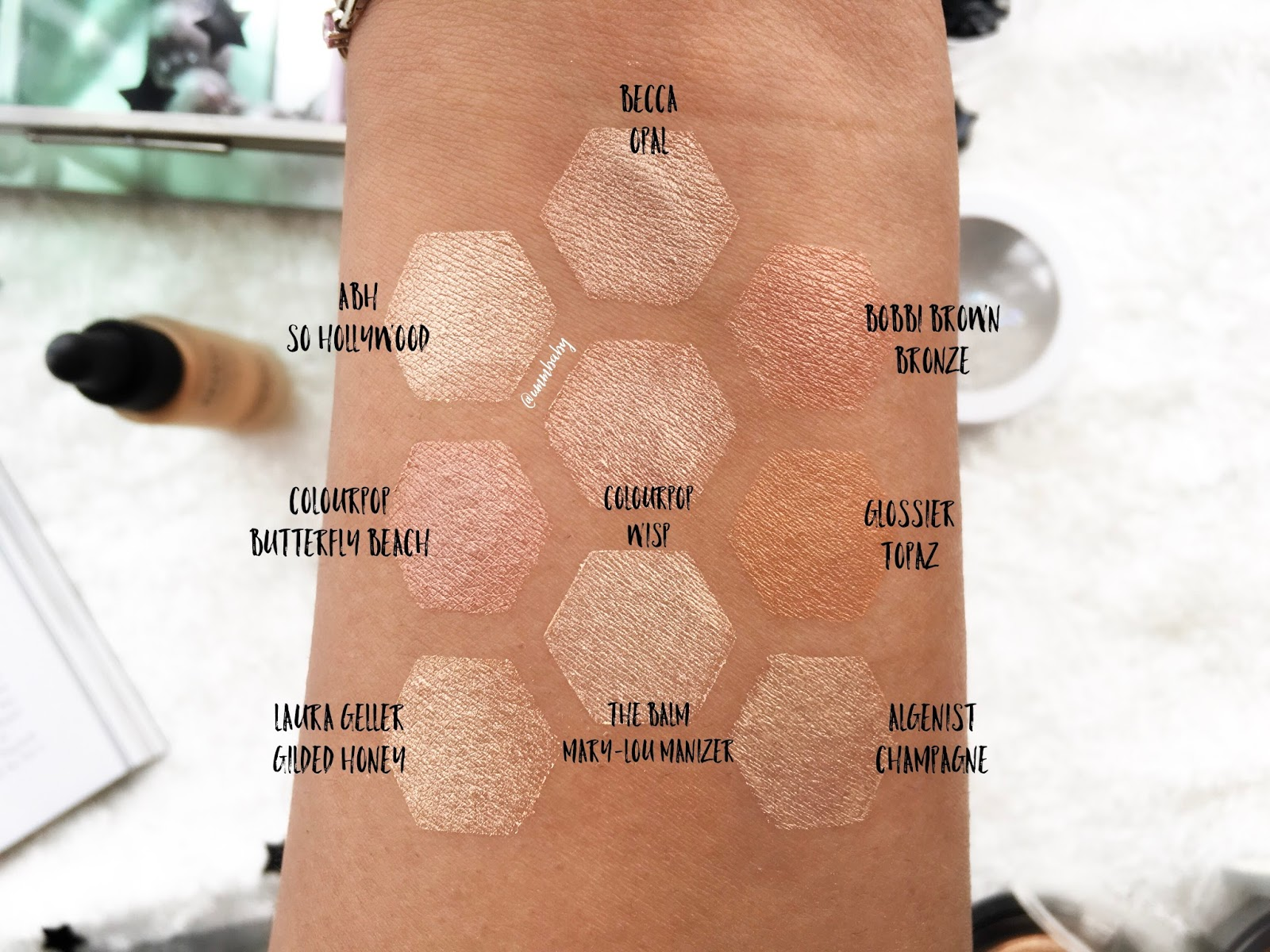 nc40 nc42 swatches highlighters, the balm mary lou manizer swatch, becca opal medium skin swatch, colourpop wisp swatch, colourpop butterfly beach swatch, glossier topaz swatch, algenist champagne swatch, abh so hollywood swatch, laura geller gilded honey swatch, bobbi brown shimmer brck swatch