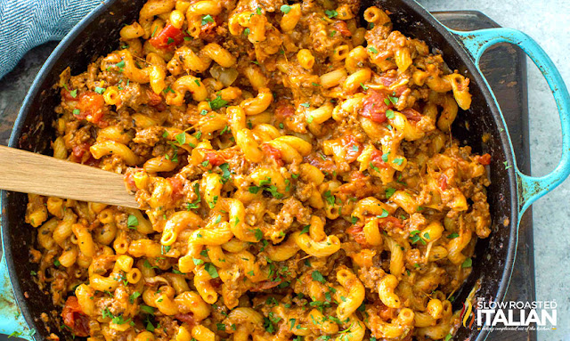 One-Pot American Goulash in a blue skillet