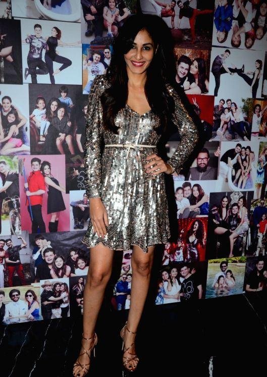 Actress Pooja Chopra Log Cross Legs Thighs Show In Black Top