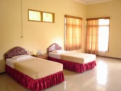 Kamar Hotel Papin Inn Pantai Pasir Putih