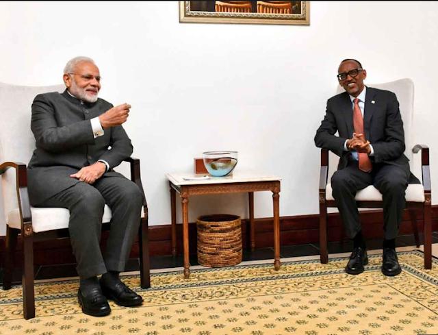 pm modi holds converses with prez kagame