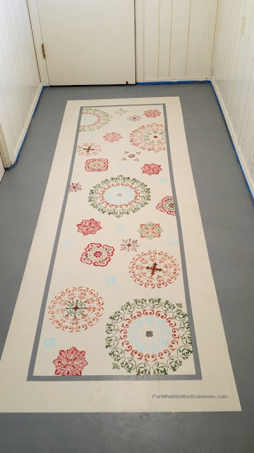 Painted floors with faux rug runner in medallion pattern