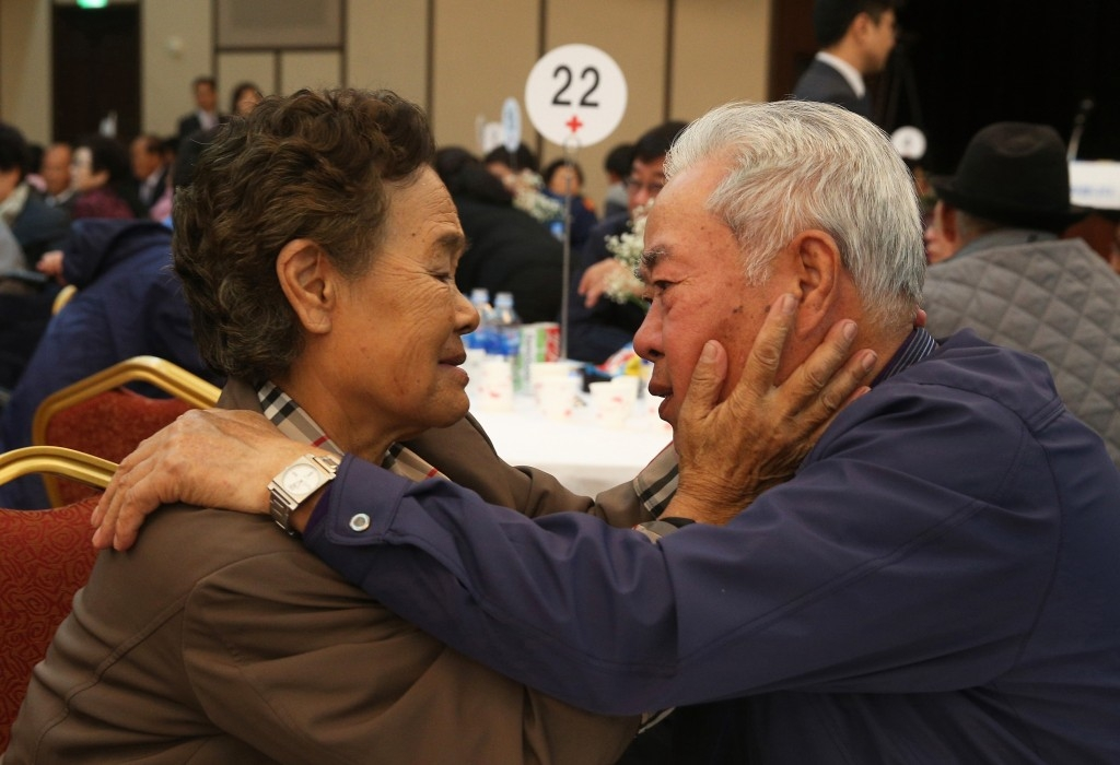 70 Of The Most Touching Photos Taken In 2015 - South Korean Lee Cheon-Woo cries as he becomes one of 90 people to be briefly reunited with their North Korean relatives. More than 66,000 people are on a waiting list to see their loved ones.