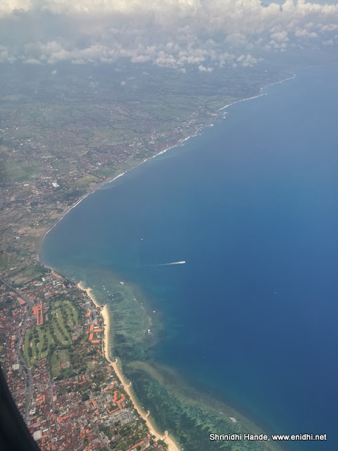 scenic views of Bali indonesia from window seat of malindo plane