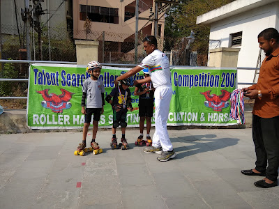 skaters at prize distribution won medals