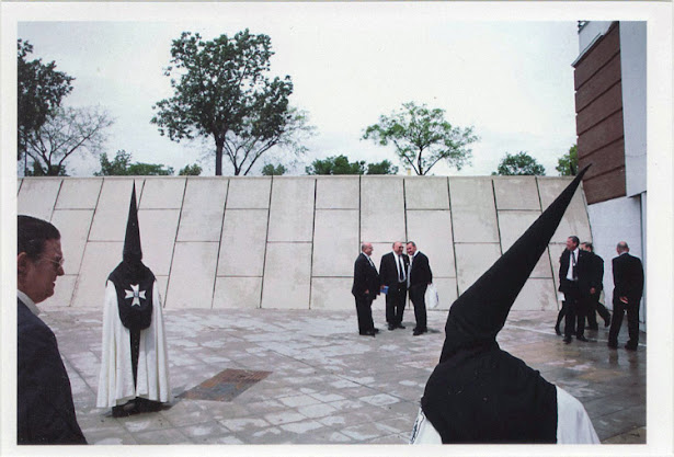 dirty photos - Once - street photo of people dressed with suits and kukluxklan clothes at triana , sevilla