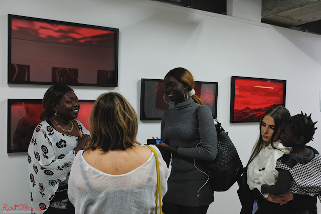 "Visitors to ""I See Red"" at Contact Sheet - Head On - Photo by Kent Johnson for Street Fashion Sydney."