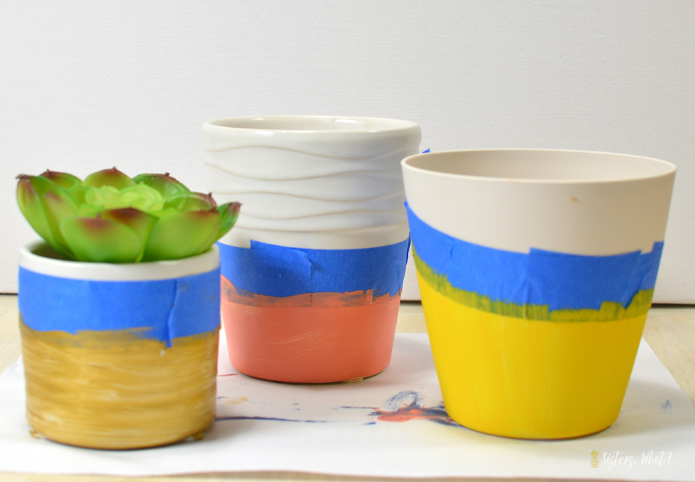 use frog tape to create a colorful pattern on flower pots