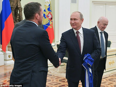 Rio Ferdinand meets with PUTIN at the Kremlin as outrage over Novichok crisis continues in Britain
