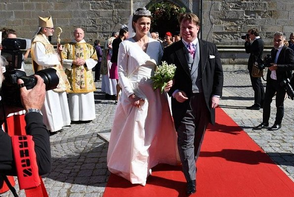 Grand Duchess Maria Teresa, Belgian Princess Astrid and her husband Prince Lorenz at wedding ceremony in Germany. wedding dress and tiara
