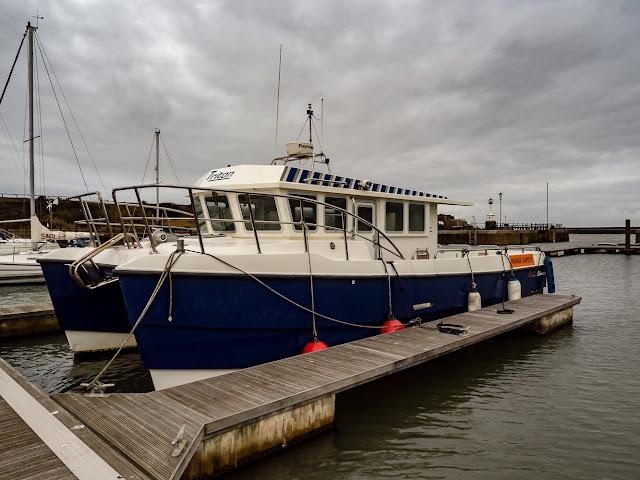 Photo of the range safety boat Triton at Maryport Marina