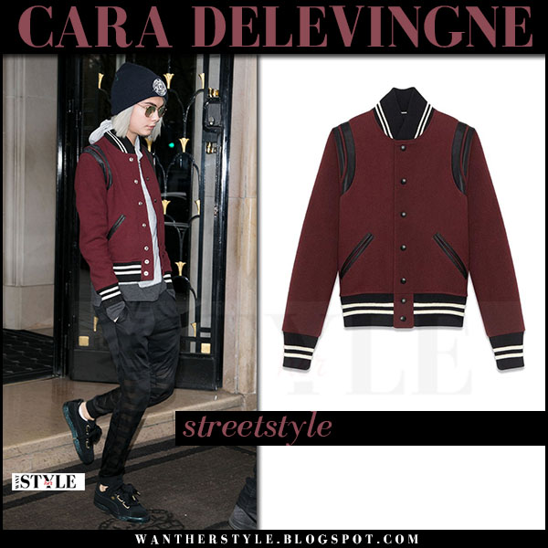 Cara Delevingne in burgundy bomber jacket saint laurent and black pants what she wore