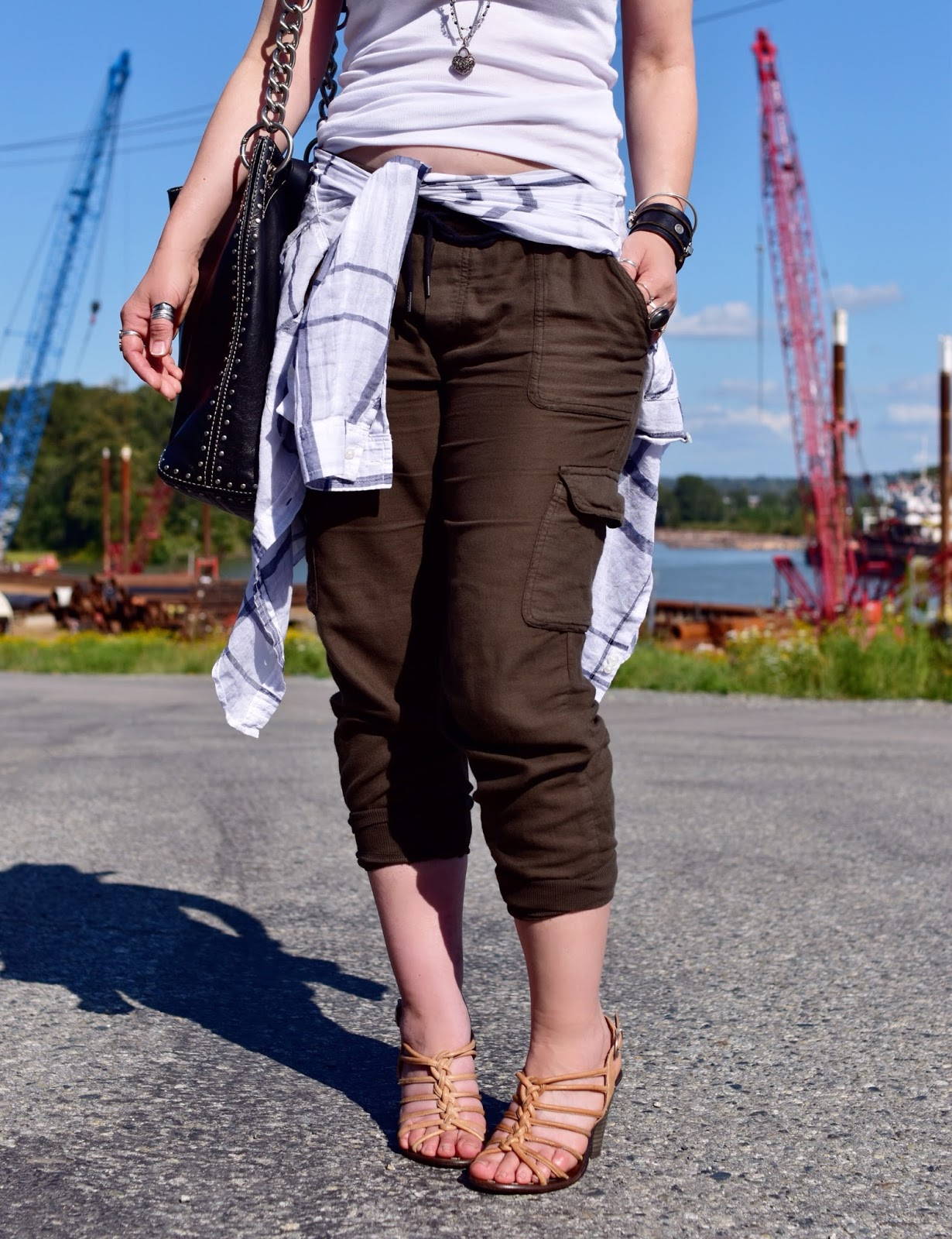 slouchy cargos, waist-tied plaid shirt, strappy nude sandals, and studded MK bag