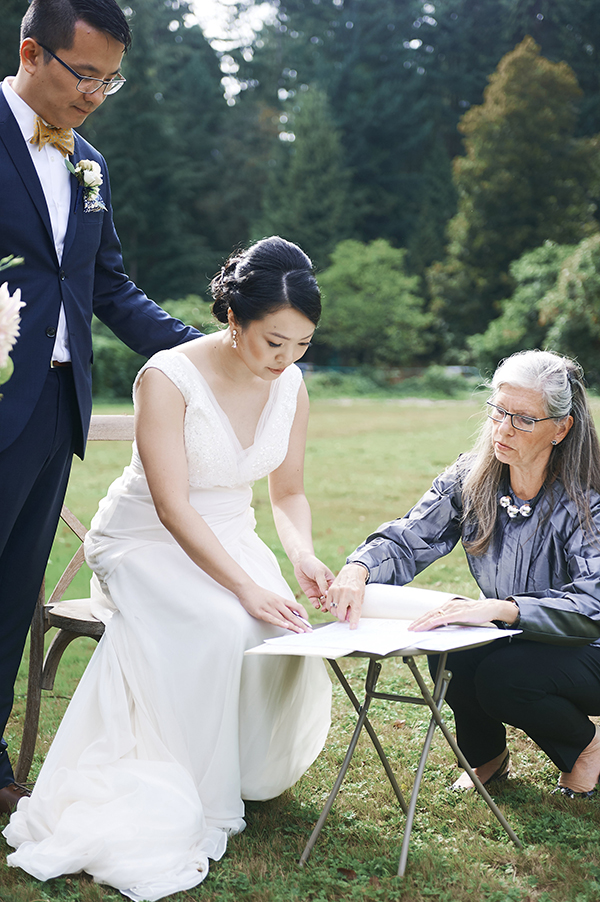 Signing the BC marriage license with the officiant