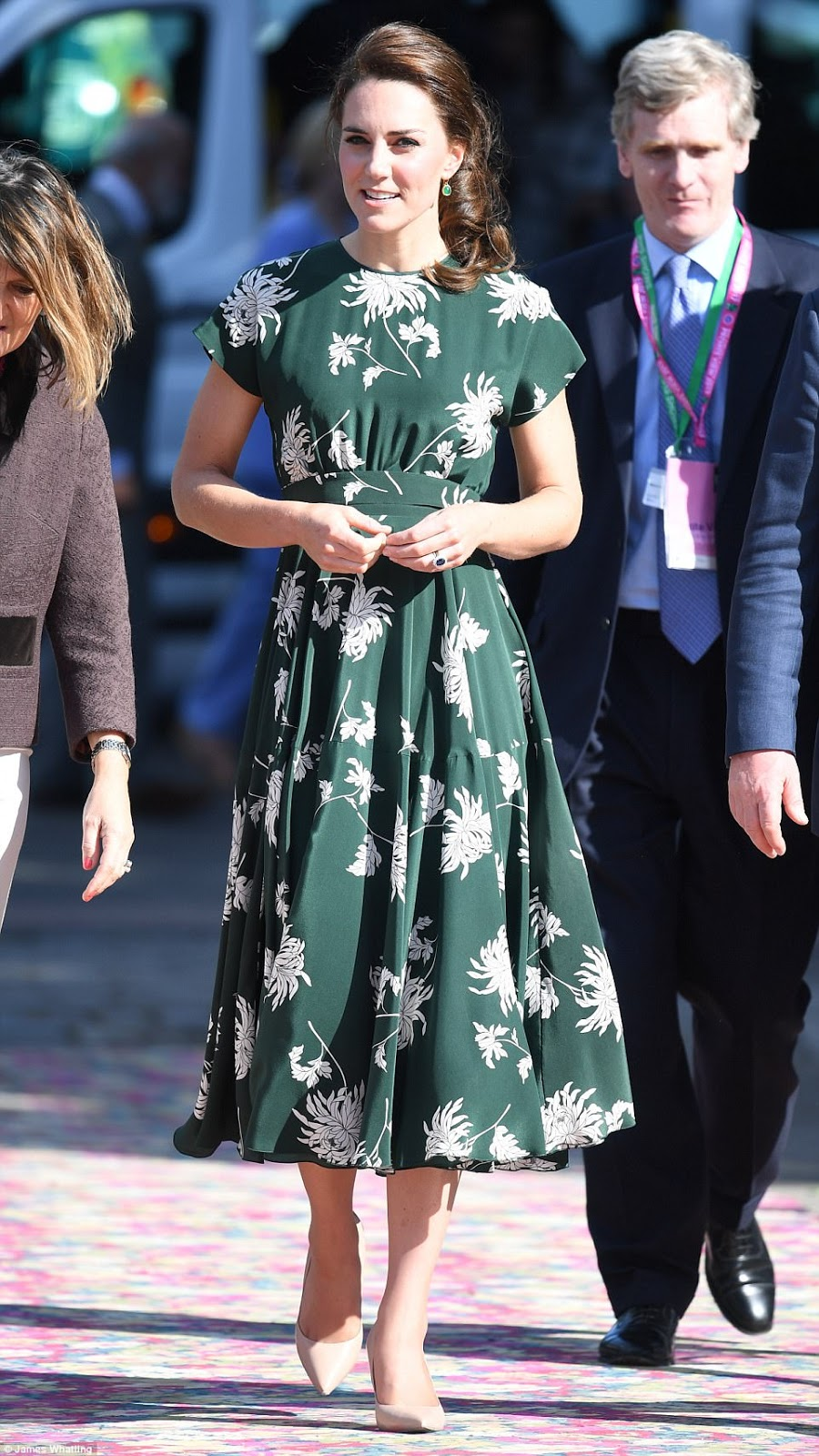 Kate looked stunning in a midi length £1,500 green dress with a white floral print by Rochas