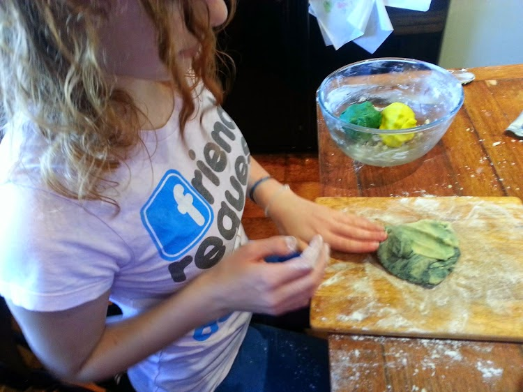 Kneading colour into cookie dough