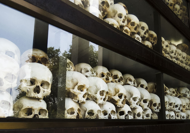 Memorial stupa containing over 5000 human skulls at Choeung Ek in Phnom Penh Cambodia