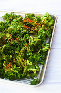 curly kale in a baking tray, sprinkled with paprika