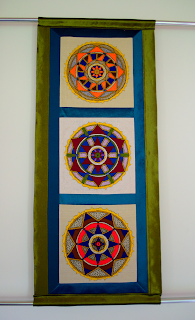 three hand embroidered yantras
