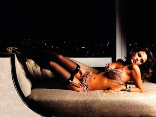 Josie Maran Laid On Couch