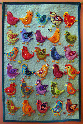 Chickadees, a wall quilt by Carrie Unick, embroidery on wool applique