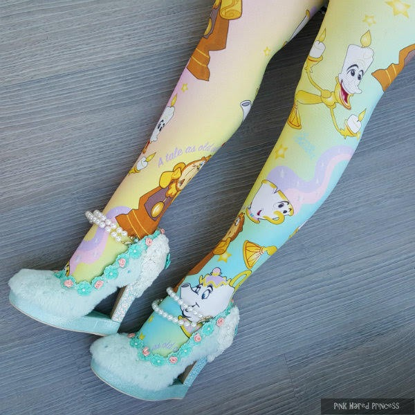 legs wearing mint furry shoes and pastel rainbow disney tights