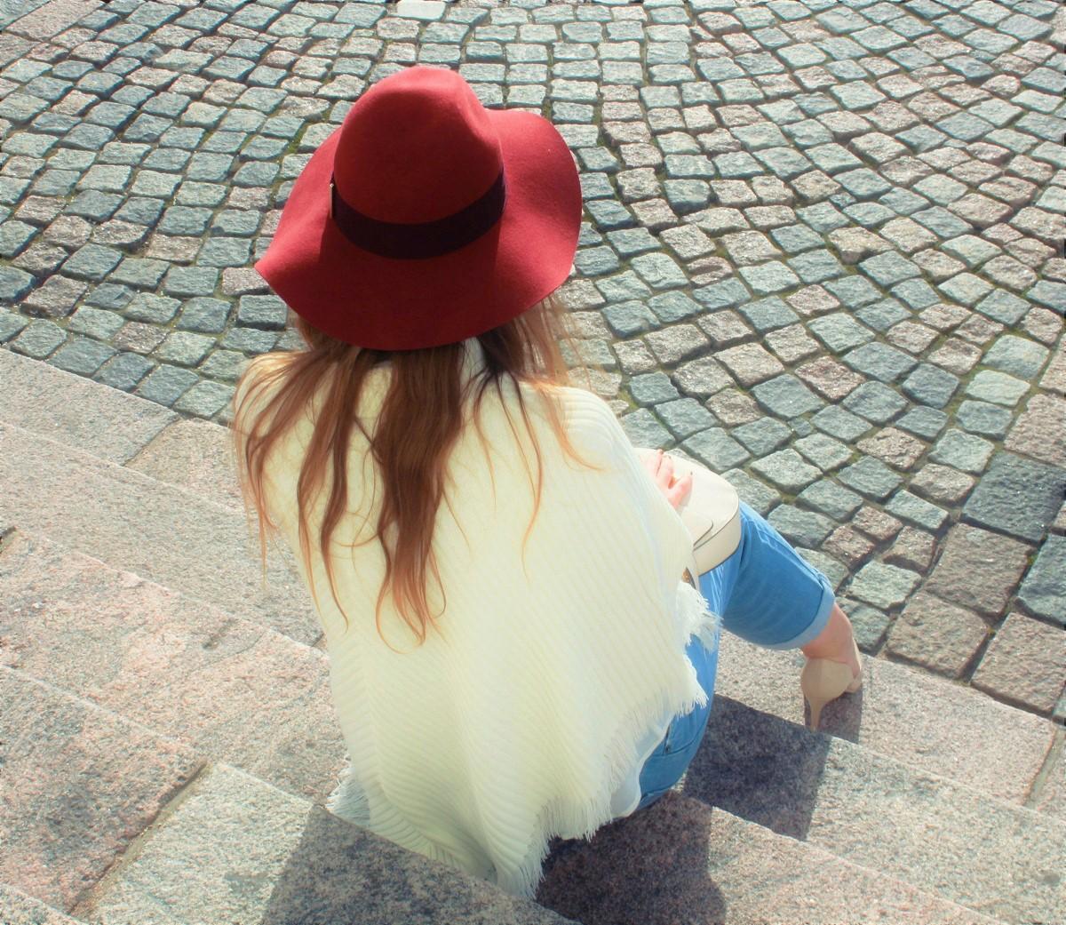 white poncho, red felt hat