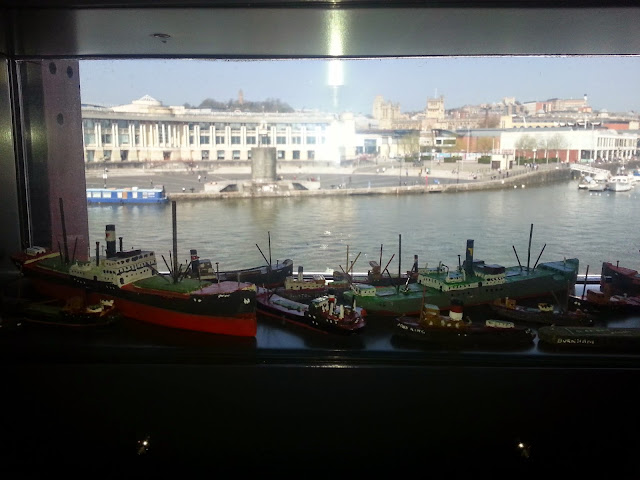 A view of the harbour through the window of M Shed