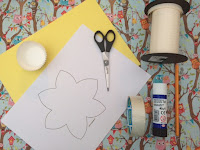 Craft items, including card, scissors, tape, cake cases, ribbon, pencil and glue
