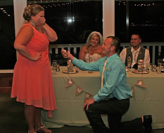 Wedding guest rudely upstage newlywed by proposing to girlfriend in front of them.