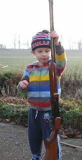 over and under .410 shotgun and boy in thomas the tank engine hat