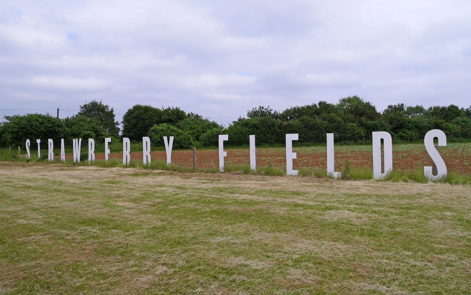 'STRAWBERRY FIELDS' sign at Cammas Hall Fruit Farm in Essex