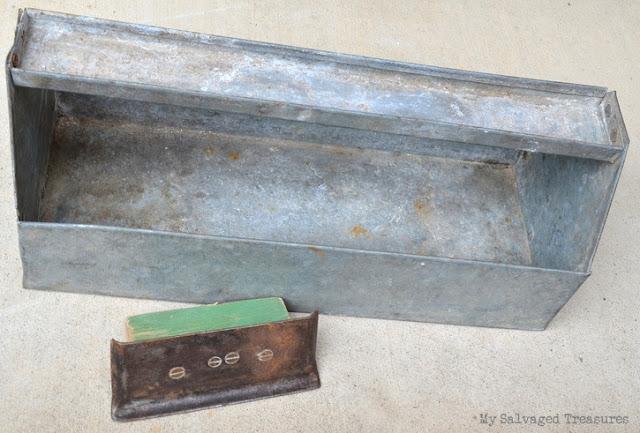 vintage concrete edger and a galvanized garden tote