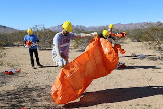 Team Rubicon students undergo fire shelter inspection from Phil Lind, BLM Smoke Jumper Training Manager.