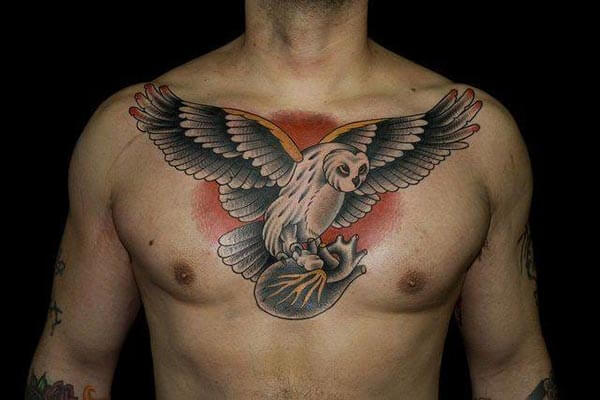 owl tattoo on the rib cage