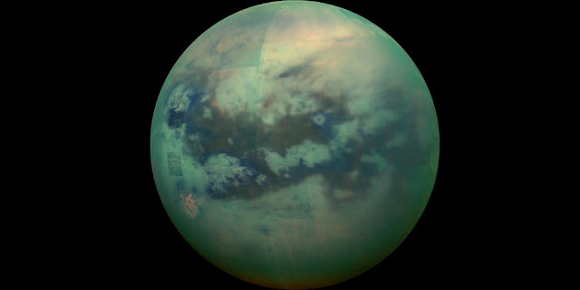 Composite image showing an infrared view of Saturn's moon Titan, taken from NASA's Cassini spacecraft. Some measures suggest that Titan has the highest habitability rating of any world other than Earth, based on factors such as availability of energy, and various surface and atmosphere characteristics. Credit: NASA / JPL / University of Arizona / University of Idaho.