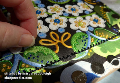 Adding the beaded filling on the last two green leaves at the top of Wild Child. (Wild Child Japanese Bead Embroidery by Mary Alice Sinton)