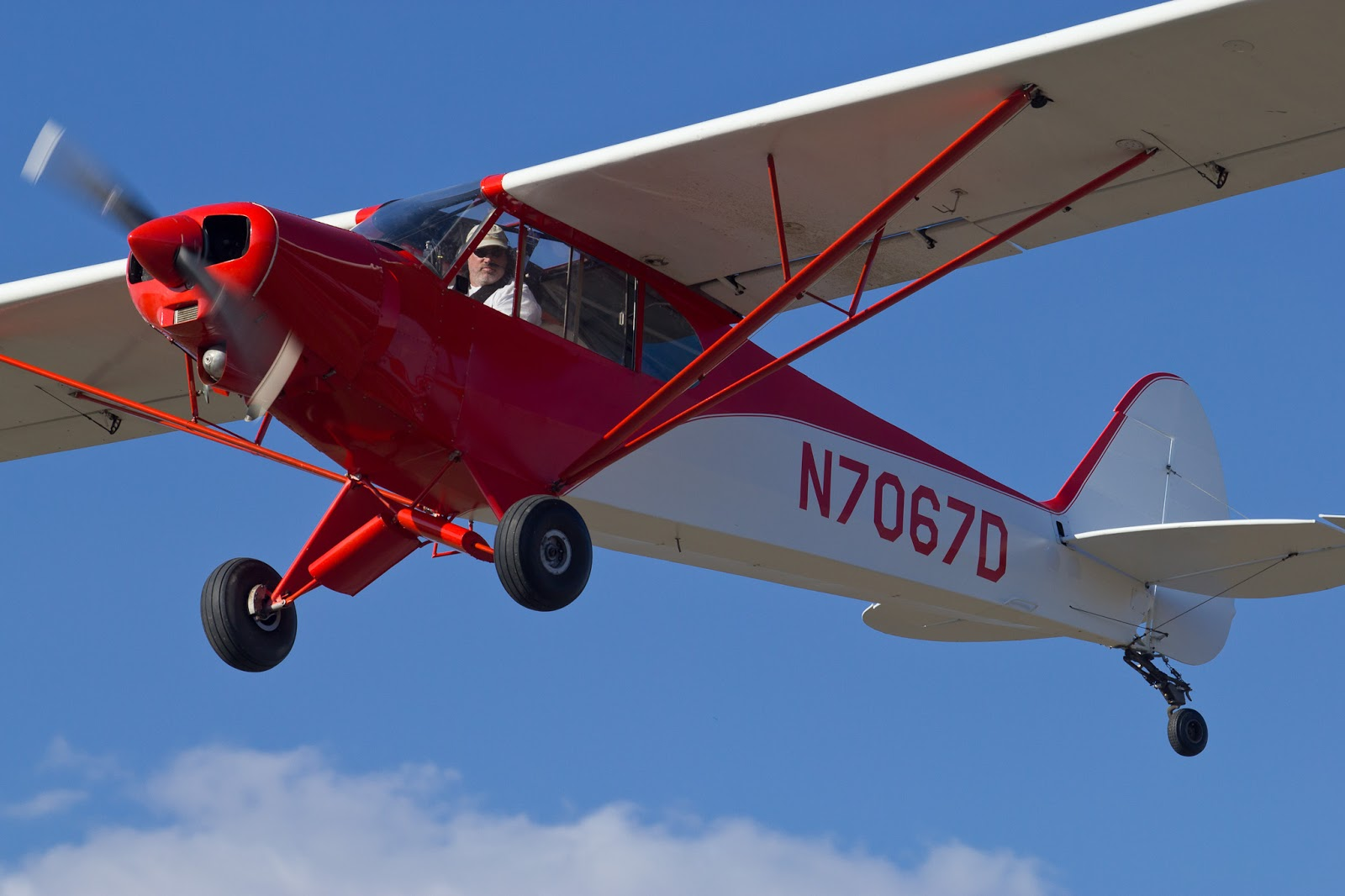 Single-engine airplane over Randall Airport