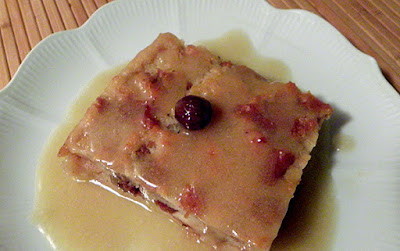 Square of Bread Pudding topped with Bourbon Sauce