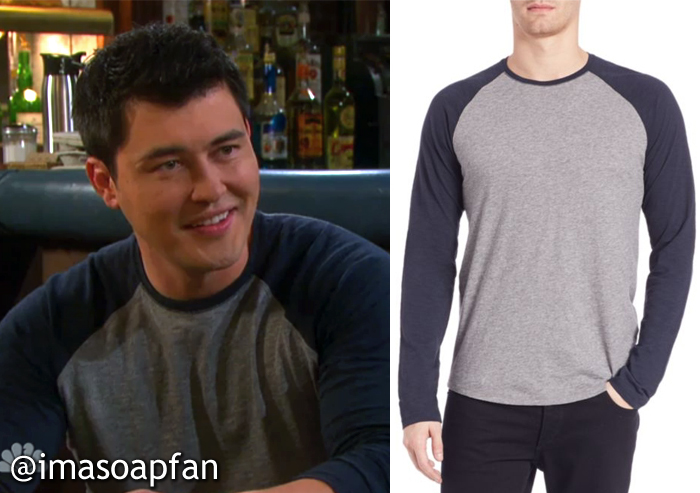 Paul Narita, played by Christopher Sean, on Days of Our Lives wearing a grey and navy blue raglan tee.