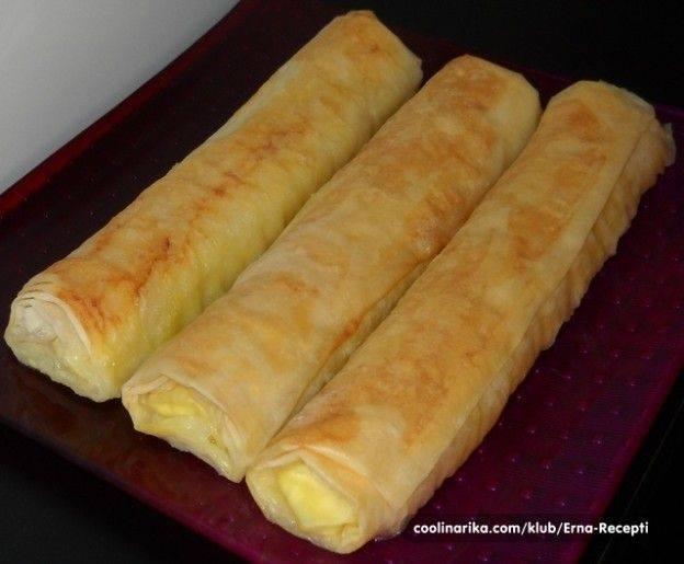 Slikovni rezultat za Sastojci 500 gr kora za pitu 300 gr sira 2 jajeta ulje so Premaz: paketić kvasca malo šećera so 3 jajeta 4 šoljice mlijeka 2 šoljice ulja 22 kašike mekog brašna