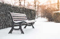 picture of a snowy bench