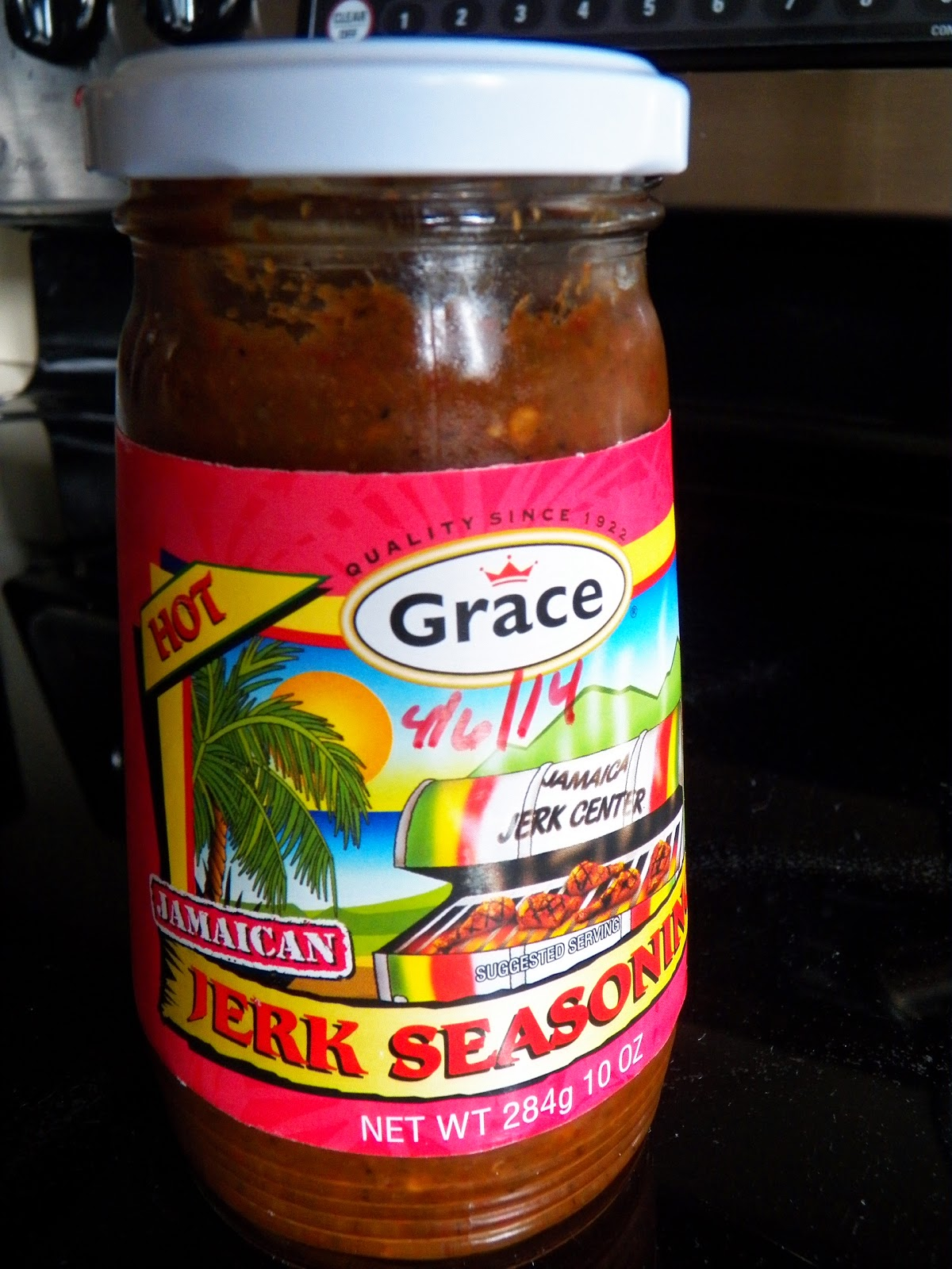 a glass jar of Jamaican jerk seasoning