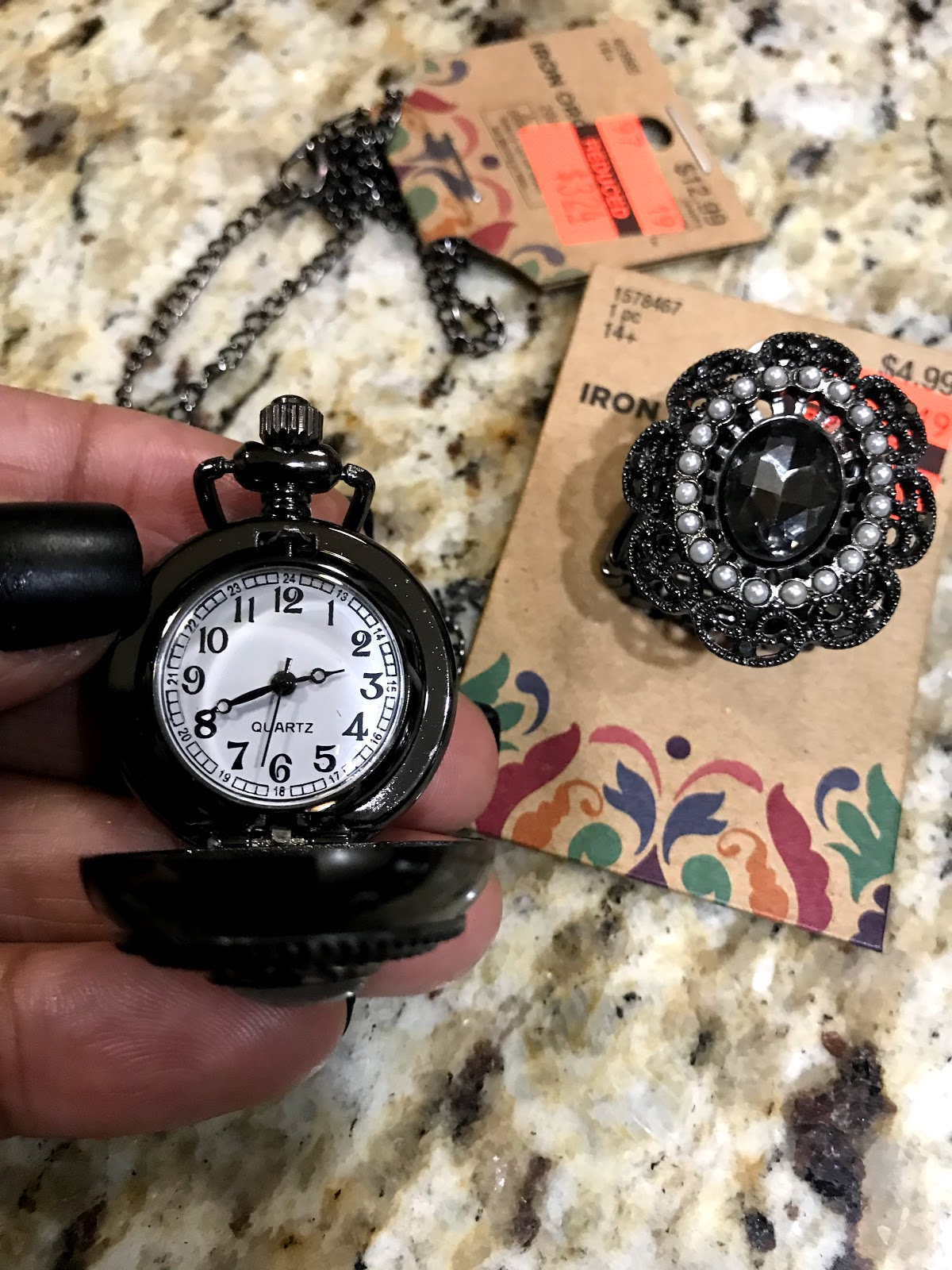 Image: Clock necklace and ring on sale at Hobby Lobby Craft Store